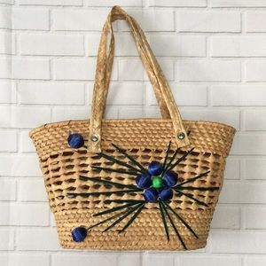Woven wicker straw basket tote bag with flowers